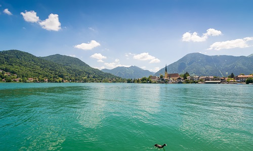 Lake Tegernsee in the Alps of Bavaria on a sunny day in summer_shutterstock_1135127372.jpg