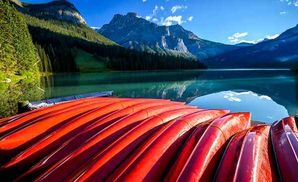 ALGONQUIN Red kayaks at Emerald Lake in Canadian Rockies  Yoho National Park  Alberta  Canada shutterstock 551871289