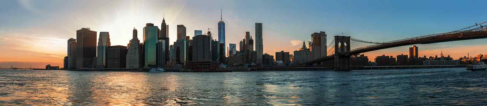BUS-NY-FL Panorama of Manhattan Skyline and Brooklyn Bridge during sunset seen from Brooklyn Bridge Park shutterstock 536174290