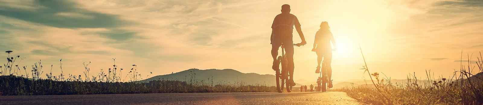FUGGER-AUG-RO  Cyclists are on the sunset road  shutterstock 498444379