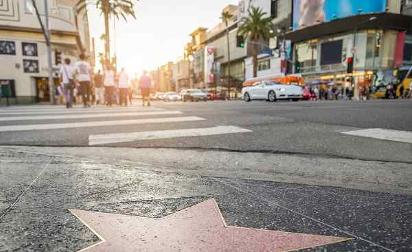 HARLEY-HOEHEP-WEST Los Angeles Walk of Fame at sunset on Hollywood Boulevard shutterstock 339446177