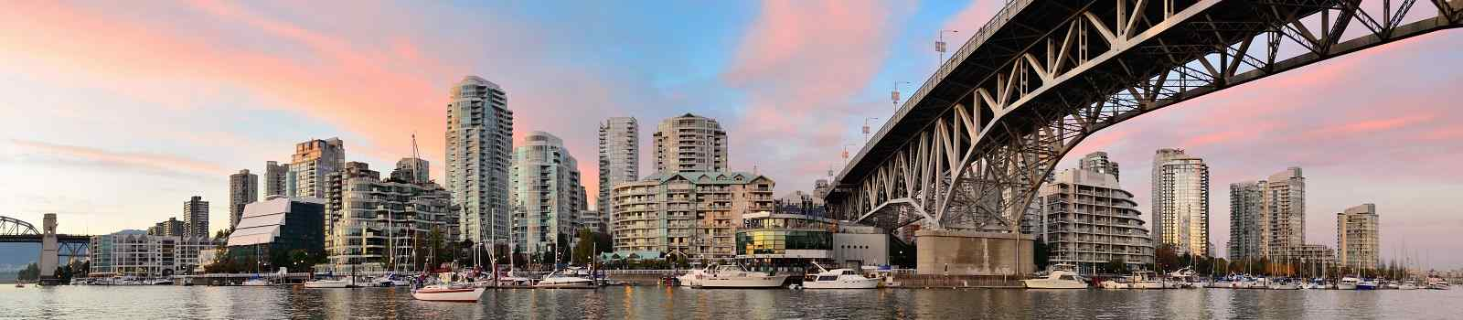 KL-CAD-ROCKIES Vancouver False Creek panorama at sunset with bridge and boat 438921508