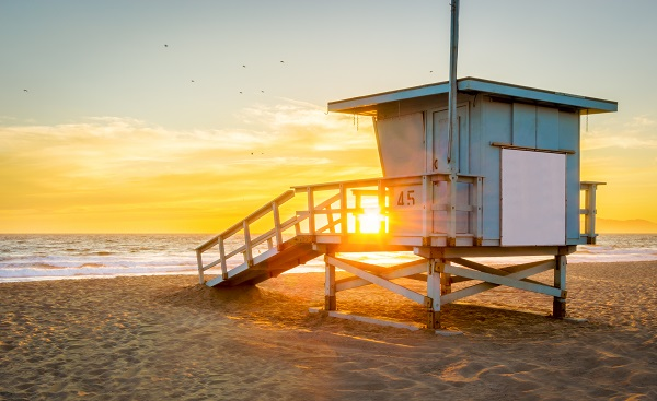 Lifeguard Tower on the Beach at Sunset with the Sun shining through  422135482