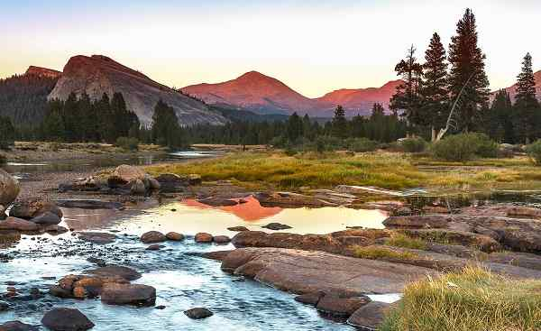 NATUR-CAMP-WEST Autumn sunset at Tuolumne Meadow on Tioga Pass  Yosemite National Park  Landscape Photography shutterstock 503789023