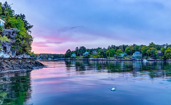 Sunset in evening at Boothbay Harbor in small village in Maine with rocky coast and houses 778478239